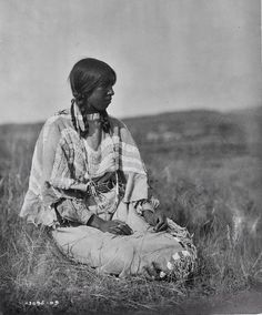 "Daughter of ""Flint Smoker"" and ""Under Beaver Woman "" Pikuni Blackfoot. Near Browning, Montana, 1909"