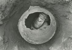 Photo from the Uruk excavation in 1929/30 - Discovery of the statuette of a 'high priest' in a vessel. 3000-2000 BCE.