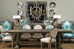 Lots I like about this dining room... the splashes of turquoise, the symmetry, the rustic pieces.