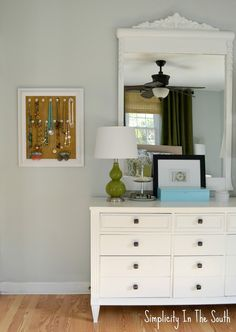 Blue and green master bedroom. Dresser and mirror painted white by Simplicity In The South.