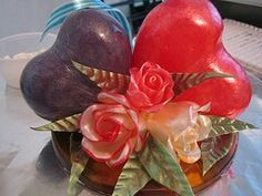 Blown sugar hearts and pulled sugar roses together as a beautiful cake topper