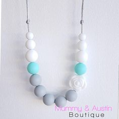 • Mummy & Austin Boutique • • PRODUCT DETAIL • Silicone Teething Necklace on a white nylon cord. Colours are light grey white and a paradise island blue • NECKLACES • All Mummy & Austin Boutique necklaces are for stylish mums to wear, designed to fit in to your lifestyle. They are