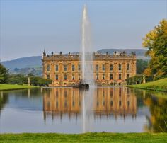 Chatsworth House - A view down the canal to the main house with the Emperor Fountain in it's full glory - from PicturesofEngland.com