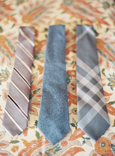 grey-tan-ties-groom-groomsmen-wedding-style  I would love it if the grooms men could all have different ties