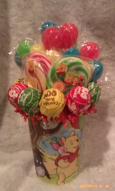 One made to order Winnie the Pooh Lollipop Bouquet. A cute and adorable gift idea for that Winnie the Pooh fan young or old or great table centerpieces at your next Winnie the Pooh Birthday Party.  **Cup is reusable** **Lollipops are all edible and YUMMY**