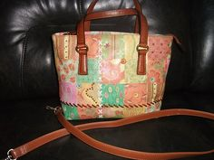 SOLD Fossil  patchwork Crossbody Leather Print Purse Crossbody or hand bag. Strap is Removable, Super Soft Leather Embellished with Leather Flowers and Studs 2 Full Slip Pockets Inside Zip Close Center. Lo