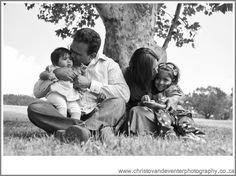 A black and white image of beautiful family.