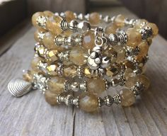 RESERVED Golden Quartz Multi Strand Memory Wire Bracelet With Crab & Shell Charms