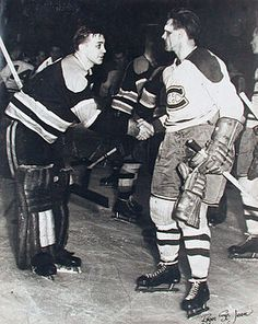 """Black Eyed Boston Goalie """"Sugar"""" Jim Henry Shakes Hands With a Bloodied Maurice Richard After Montreal Defeated Boston In Game 7 Of The 1952 Semi-Finals; One of the most famous photos in Original 6 Hockey"""