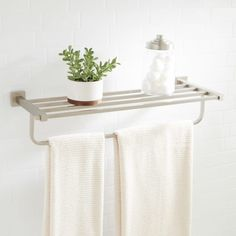 """Signature Hardware 916706 Albury 24-1/2"""" Brass Towel Rack Add storage, space and beauty with the Albury Collection Towel Rack. Ideal for a hallway area or bathroom, this towel rack is made from solid brass.Signature Hardware 916706 Features:Covered under Signature Hardware's limited lifetime warrantyConstructed of brassAll hardware required for installation is includedSignature Hardware 916706 Specifications:Overall Width: 24-1/2"""" (from left to right of product)Height: 5-1/2"""" (top to…"""