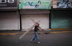 A boy in Mexico City carries a cross as he takes part in a procession during Holy Week, which commemorates the last week of the life of Jesus, culminating in his crucifixion on Good Friday and his resurrection on Easter Sunday.