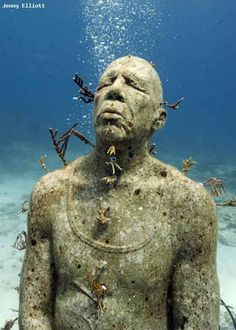 One of the fantastic statues diveable on the ocean floors near Cancun's Sculptural Museum.