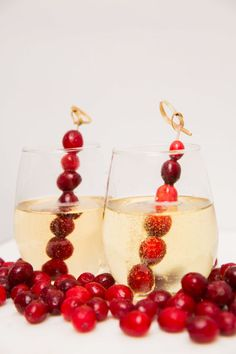 Frozen berries to keep champagne chilled.