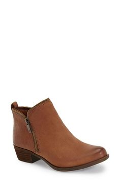 Free shipping and returns on Lucky Brand 'Bartalino' Bootie (Women) at Nordstrom.com. Edgy zipper teeth trace the topline of a chic bootie boosted by a low, stacked heel.