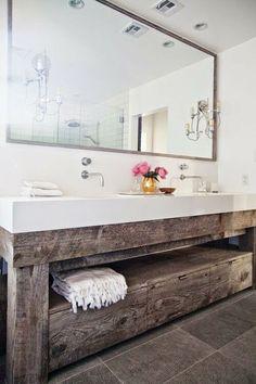 We adore this reclaimed wood bathroom vanity.