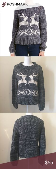 NWOT Free People Dancer and Prancer Sweater Small Chic-and-boxy pullover sweater made in a chunky knit with plenty of homespun charm. A couple of reindeer friends and a Norwegian-inspired motif seal the deal on this fireside essential.  56% acrylic, 35% wool, 9% cotton.  New without tags. Size Small. Free People Sweaters Crew & Scoop Necks