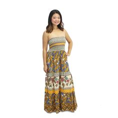 Make a bold fashion statement with this stunning strapless maxi dress. The bodice of this dress features striped patterning in elegant detail, while the skirt is loose fitting and has multiple exquisite prints.