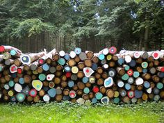 "Part of the landart project ""Outstanding Halsnæs"" (paint decoration on stack of wood)"