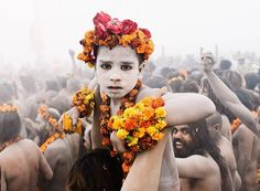 A child Sadhu is held up during the Ardh Kumbh Mela procession toward the sangam.   Photograph by Greg Vore