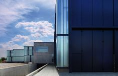 Lissoni Architettura -projects - Milan, 2011A new production centre for the glass manufacturing company. The building is the expansion of the old headquarters near Milan. The final effect is a large...