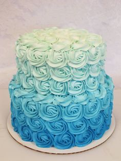 ombre rosette cake  OKAY BUT I WANT THIS IN PINK... LIKE THE CREAM/YELLOW THAT FADES INTO LIGHT PINK