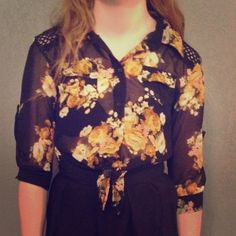 Sheer Floral Crochet Tie Waist Blouse Sheer black blouse with an all-over floral print. Crochet yoke detail. Button up front. Tie waist. Fits a women's size medium. Tops Blouses