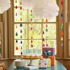 These rainbow shower mobiles would be perfect decorations for a baby shower.