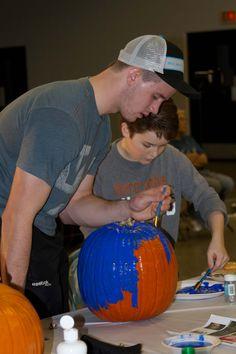 Carter Foguth and Dylan McKenzie work on their pumpkin