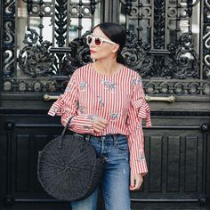 that round black straw bag is the best! Also love her red top and jeans and sunglasses - basically everything about this look. Cool Outfits, Summer Outfits, Fashion Outfits, Trouser Outfits, Moda Paris, Fashion Details, Paris Fashion, Passion For Fashion, Spring Summer Fashion