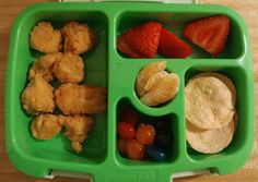 7 yr old lunch: Popcorn chicken, strawberries, oranges, baked chips, & gushers fruit snacks.