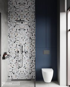 Terrazzo wall accent for the shower area. Blue color in the terrazzo repeated on the adjacent water closet area. Vertical stripes contrasting against the terrazzo pattern. Storage above the water closet, behind subtle cabinet doors. Beautiful Bathrooms, Modern Bathroom, Small Bathroom, Basement Bathroom, Bathroom Ideas, Master Bathroom, Compact Bathroom, Minimal Bathroom, Neutral Bathroom