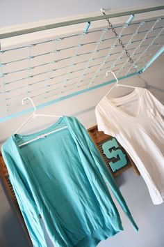 Crib Spring Drying Rack suspended from ceiling to hang wet clothes. www.adiamondinthestuff.com