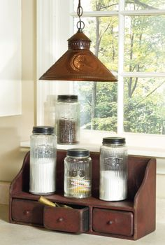 enhance your kitchen with this hanging punched-tin pendant light, embossed-glass Hoosier-style canisters and highback shelf with drawers... order these items at http://www.oldefarmcreek.com/store/Default.asp