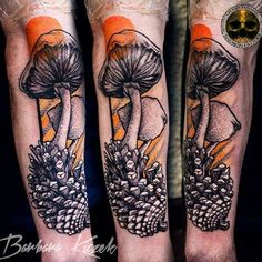 Black and grey mushroom tattoo on arm by Barbara Kiczek