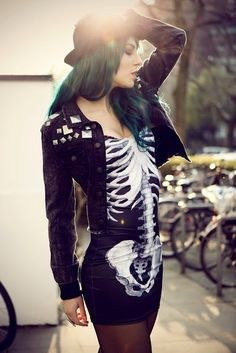 rock n' roll chic. skeleton dress, studded black denim jacket and green dyed hair.