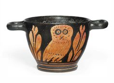 A GREEK RED-FIGURED OWL SKYPHOS   SOUTH ITALIAN, CIRCA MID 4TH-CENTURY B.C.   Each side with an owl facing right, its head turned frontally, framed by laurel sprigs, on double reserved groundline  3 in. (7.7 cm.) high