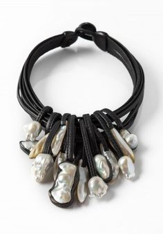 $2,695.00 | Monies UNIQUE Baroque Pearl and Mother of Pearl 8 Strand Leather Necklace | Monies jewelry is bold in design and strong in aesthetic. This Monies necklace is made with Baroque Pearls, Leather, and Ebony, to become a one-of-a-kind and edgy statement piece. All pieces are handmade. Monies is sold online and in-store at Santa Fe Dry Goods & Workshop in Santa Fe, New Mexico.