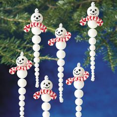These snowmen snowcicles are made by stringing beads and wrapping candy cane chenille stems together, very sweet.