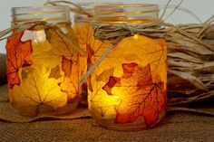Leaf Mason Jar Candle Holders | Apply real or faux leaves to the outside of an empty Mason jar, then add a candle and marvel at the stained glass look.