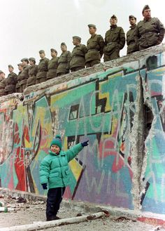A young West German girl smiling at her father as she points to a large hole in the #Berlin #Wall Nov. 11, 1989. More information on Berlin: visitBerlin.com