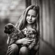 girl with puppies by Izabela Urbaniak on 500px