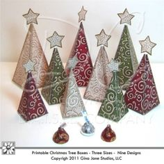 Printable Christmas Tree Boxes - Pyramid Shape Boxes. Trees with stars on top.  Fill with candy, trail mix, small gifts, etc.  Smallest Tree box holds four Hershey Kisses.  All designed by Gina Jane for DAISIECOMPANY