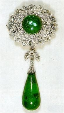 From Her Majesty's Jewel Vault: The Round Cambridge Emerald Brooch.