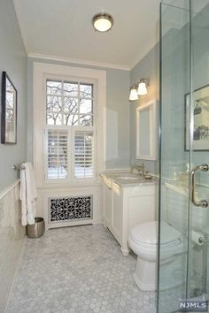 Traditional 3/4 Bathroom with Hexagon white carrera marble mosaic, Paint 1, three quarter bath, flush light, picture window