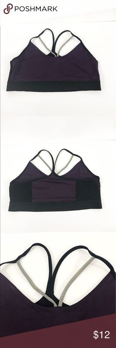 Champion sports bra Sexy purple sports bra with goldfish silver detail on chest.  Mesh design on side . Racerback straps on back . Straps are not adjustable . Measurements : bottom width : 17 in. Armpit to armpit : 18 in. Shoulder to armpit : 10 in. Champion Intimates & Sleepwear Bras