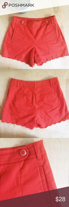 "Anthropologie Scalloped Hem Shorts Anthropologie Cartonnier size 0 red orange scalloped hem shorts with retro style buttons at front waistline. Slash pockets in front and back. Hidden side zipper and button. 96% cotton 4% spandex. 4"" inseam. Approximately 9"" rise. See additional measurements in pics. In gently used condition. No stains, holes, or pilling. A small amount of fading around the back pockets (see last pic). Anthropologie Shorts Bermudas"
