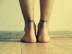 Little achilles tendon tattoo of two numbers in roman numerals.