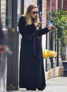 Mary-Kate Olsen pops out for a smoke break in NYC wearing baggy robe | Daily Mail Online