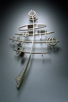 Kristin Mitsu Shiga - Totem Brooch (Sterling silver, ebony, piano key ivory scrimshaw)