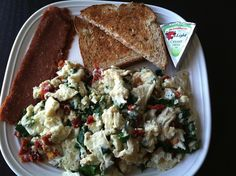 Scrambled eggs with spinach and sun-dried tomatoes, toast with The ...